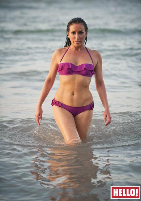 HELLO Magazine Nancy Dell'Olio wears Carizzi designer bikini fuchsia